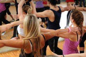 Dance fitness classes typically begin with stretching, then add steps from aerobics, jazz dance, funk, hip-hop, country and other dance styles.