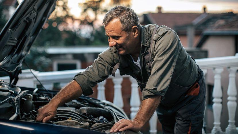man fixing his car