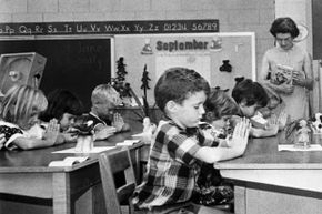 """First graders pray silently in a South Carolina public school in 1966. At the time, the state's school districts left the """"prayer issue"""" to the teacher's discretion."""