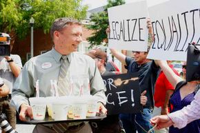 A Chick-Fil-A employee tries to hand out lemonade during a protest at a Chick-Fil-A restaurant in Decatur, Ga. in 2012. People protested the chain nationwide after the COO (the son of the founder) voiced opposition to gay marriage.