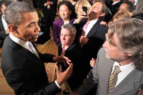 President Barack Obama shares some thoughts with Charles King of Housing Works, who heckled the President during his remarks on the National HIV/AIDS Strategy in 2010.