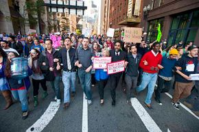 A group of protesters, including Princeton professor Cornel West (center), march in Boston during the Occupy Boston movement to protest corporate greed. See more protest pictures.
