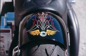 The flying eyeball gracing Rigid's rear fender replicates artist Von Dutch's signature logo.