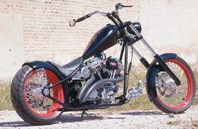 Rigid chopper's red-rimmed spoke wheels.