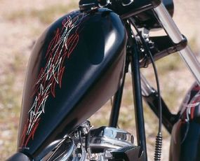 Artist Von Dutch is famous for his pinstriping designs, the likes of which are portrayed on the Rigid chopper.