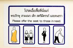 A sign in a train in Bangkok, Thailand reminds riders to give priority seating to the elderly, pregnant women -- and monks.