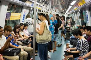 Large bags and backpacks can become inadvertent weapons on a train (like this one in Singapore). Be careful where you place them.