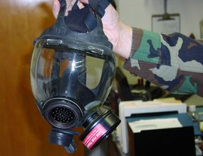 A crowd-control gas mask is based on the standard military-issue gas mask.