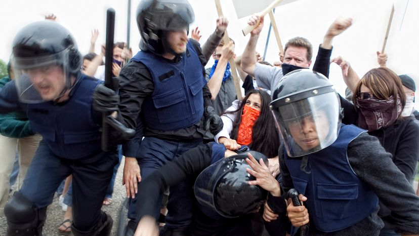Riot Police Try to Control Angry Mob