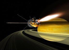 An illustration of spacecraft Cassini in orbit around Saturn.