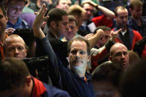 A trader signals an offer at the Chicago Board Options Exchange in December 2012 after the Fed announced it expected to keep a key short-term interest rates at or near zero percent.