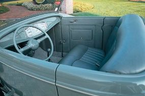 Jim Griffin Interiors stitched the green-dyed buffalo-leather interior.