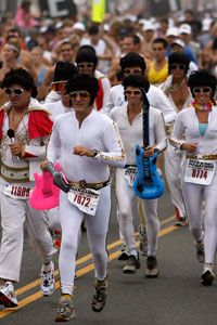 A whole herd of Elvis Presleys leads the start of the San Diego Rock 'n' Roll Marathon.