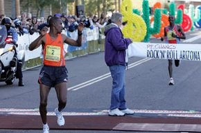 Winner Terefae Yae glances behind the finish line after completing the Arizona Rock 'n' Roll Marathon.