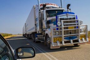 If you're approaching a road train, you need to not only stay in your own lane, but you need to stay as far left in your lane as possible. Chances are that train of trucks is using its entire lane -- and some of yours, too.