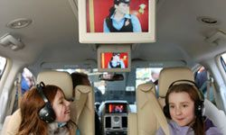 A portable DVD player with a new movie, handheld electronic games and MP3 players are big hits in the car.
