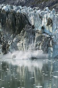 Glacial calving can cause enormous waves, but they're not considered rogue waves.
