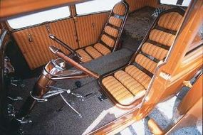 Custom-made seats with segmented cushions in between outertube frames were mounted on the floor.