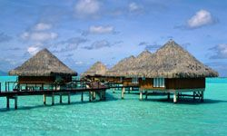 Step off your over-water hut into the water for some snorkling.