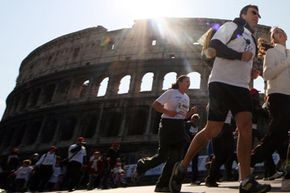 Competitors take off at the start of the 15th Rome Marathon 'Maratona di Roma' at the Colosseum on March 22, 2009 in Rome, Italy.