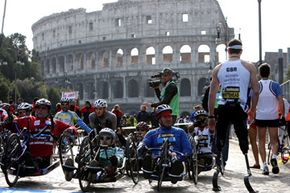 Double amputee athlete Richard Whitehead (R) of Great Britain prepares for the 15th Rome Marathon 'Maratona di Roma' at the Colosseum on March 22, 2009 in Rome, Italy.