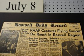 A display at the UFO Museum in Roswell, N.M., recreates headlines from the infamous incident.