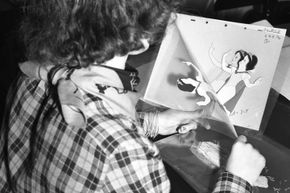 """A Disney animator working with on a character motion sequence for """"Snow White and the Seven Dwarfs"""" circa 1936."""