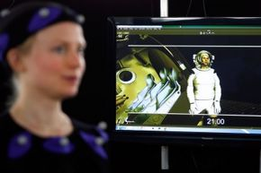 Movement of a performer wearing a motion-capture suit is translated digitally into a screen character.