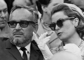 Prince Rainier and Princess Grace of Monaco comment the ongoings at the Maestranza bullfight in Seville, April 19, 1966.