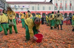 A team of orange throwers await the next team of carriages to arrive in Ivrea, Italy. The carnival's famous orange battles originate from the town's medieval heritage, when feudal lords would hand out food to the poor who reputedly threw it back as a gesture of disrespect.