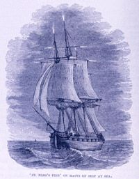 St. Elmo's torchlike flames shoot off the mast of a ship at sea.