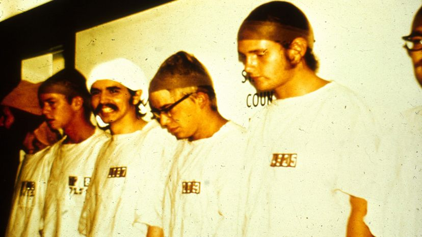 The prisoners wore smocks and stocking caps. PrisonExp.org