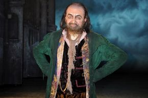 """Rowan Atkinson of Mr. Bean fame transforms into Fagin in the musical """"Oliver!"""""""