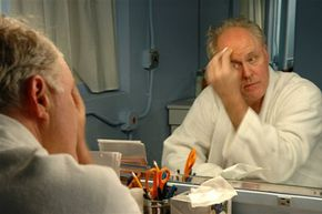"""John Lithgow begins to apply makeup before a performance of """"Dirty Rotten Scoundrels."""" See pictures of makeup tips."""