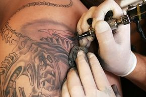 Bleeding, scabbing and itching are all normal reactions to a fresh tattoo. Bumps and pus are not.