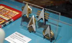 """These replica communicator badges seen at """"Star Trek -- The Exhibition"""" in Los Angeles on Oct. 10, 2009, appeared in later TV series."""