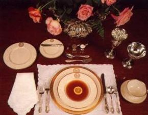 Official state place settings in china, silver, and linens