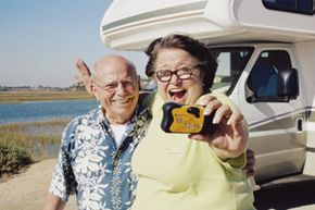 retired couple standing by RV