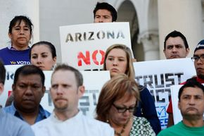 Activists and community leaders attend a rally and a news conference regarding the U.S. Supreme Court's decision on the Arizona immigration law in June 2012.