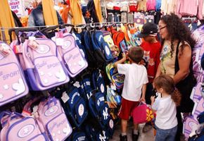 A family examines a selection of backpacks at a Brooklyn, N.Y., clothing store during a state-wide tax holiday in 2003.
