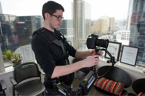HowStuffWorks video producer Paul Dechant wields the Merlin 2, a lightweight, more modern camera stabilizer system, with a Canon 7D. See more movie making pictures.