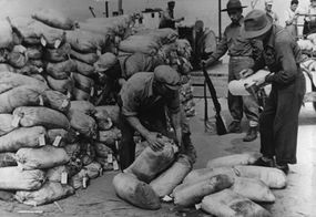 U.S. soldiers stand guard over a shipment of uranium as it's unloaded at Forth Smith in Canada.