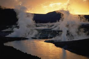 Geyser Basin erupts at twilight in an amazing display of natural steam.