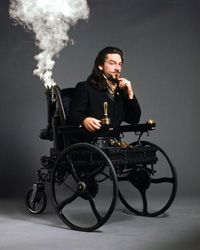 """Kenneth Branagh as Dr. Loveless from """"Wild, Wild West"""" in a steam- powered wheelchair"""