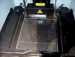 The platform in the tank of photopolymer at the beginning of a print run.