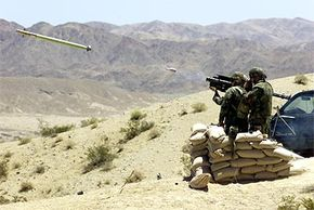 Marines launch a Stinger anti-aircraft missile at a target aircraft during a live fire exercise.