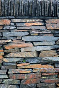 Because of its natural tendency to fracture in relatively straight lines, slate is perfect for building rock walls.