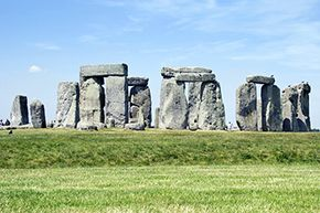 Though covered with grass, the original ditch ancient Britons dug around the Stonehenge site is still clearly visible.