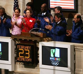 On Feb. 23, 2005, former Olympians cheer a bullish day on Wall Street. The Dow Jones Industrial Average had climbed 64 points.