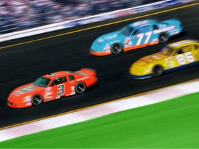 Brilliantly painted cars in race.
